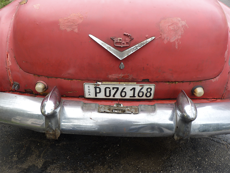 back of beaten red classic car Havana 800 px site
