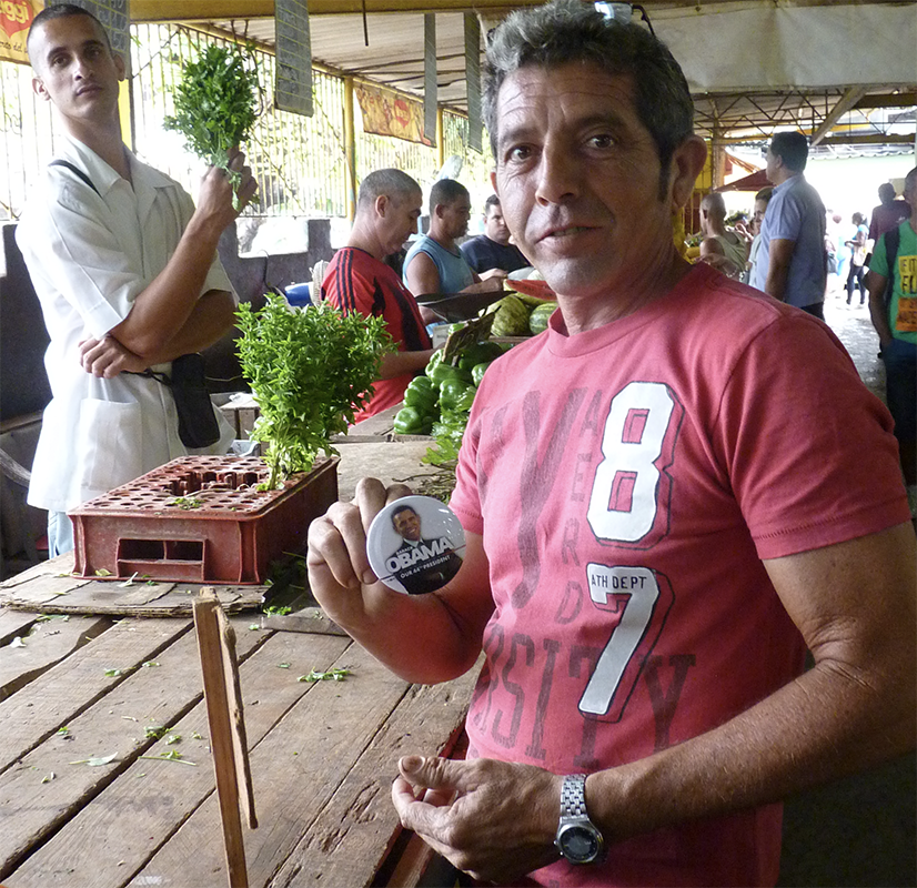 cuban man with Obama button in Mercando, 800 pix site